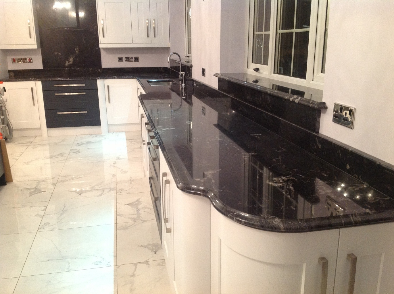 White Gloss Kitchen With Black Granite Worktop